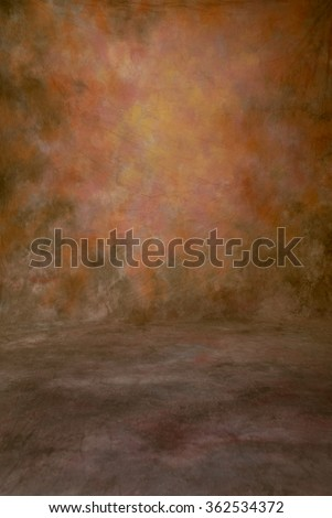 Traditional cloth photography studio portrait background or backdrop with many colors, pink, orange, ecru, etc. Shows the floor area.