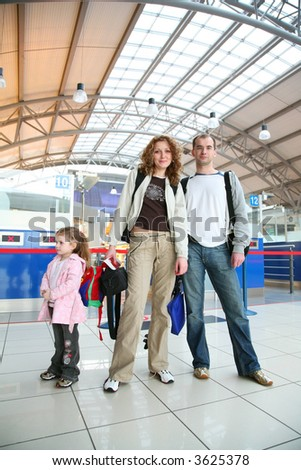 family with girl in airport #3625378