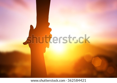 silhouette of  helpping hand  and hope concept and international day of peace.how can i help you Royalty-Free Stock Photo #362584421