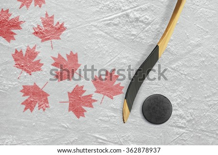 Hockey puck, stick, and a schematic representation of the Canadian flag. Concept