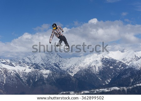 Flying snowboarder on mountains. Extreme sport. #362899502