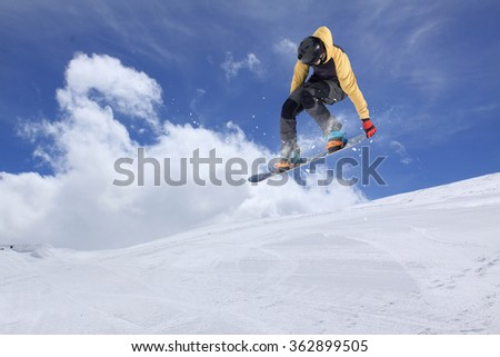 Flying snowboarder on mountains. Extreme sport. #362899505