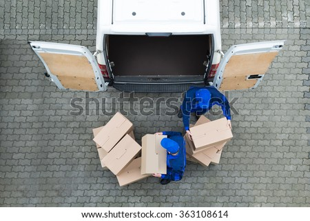 Directly above shot of delivery men unloading cardboard boxes from truck on street #363108614