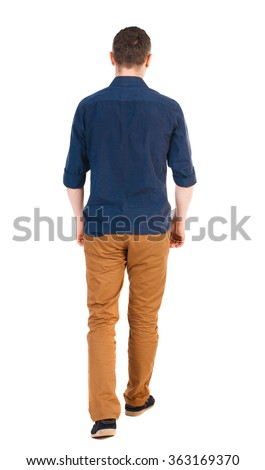 Back view of going  handsome man in jeans and a shirt.  walking young guy .  Isolated over white background.  man in brown pants, shirt sleeves rolled away into the distance. #363169370
