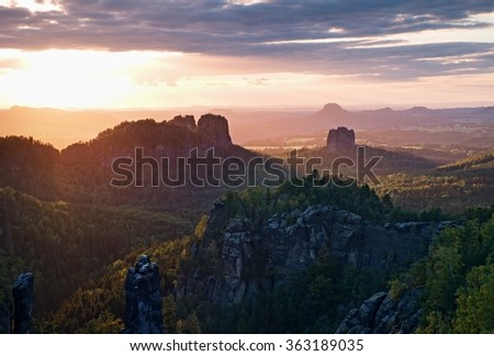 Popular climbers resort in Saxony national park, Germany. Sharp sandstone cliffs above deep valley. #363189035