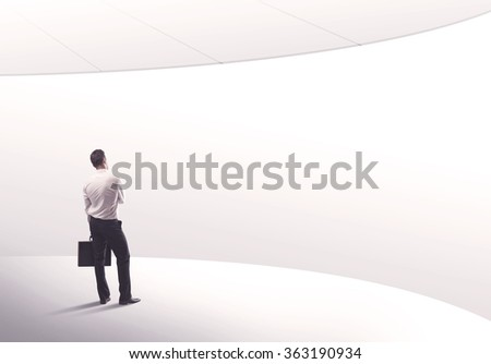 Young sales business person in elegant suit standing with his back in empty white space background with curved lines concept #363190934
