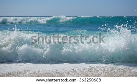 Waves crashing on the beach Royalty-Free Stock Photo #363250688