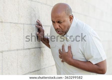 Man having a heart attack.  Royalty-Free Stock Photo #363299582