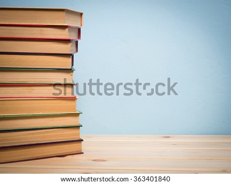 Books on a wooden shelf on a blue background #363401840