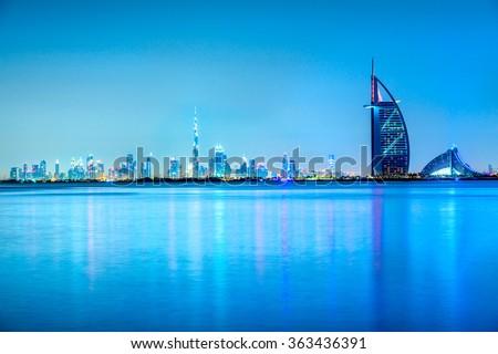 Dubai skyline at dusk, UAE. Royalty-Free Stock Photo #363436391