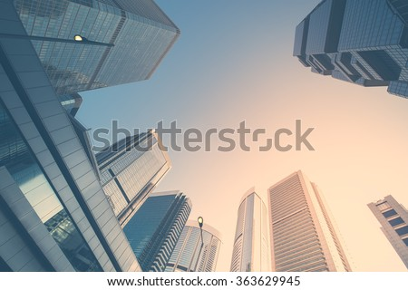Abstract futuristic cityscape view with modern skyscrapers. Hong Kong Royalty-Free Stock Photo #363629945