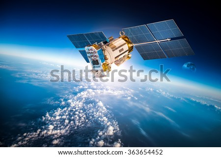 Space satellite orbiting the earth. Elements of this image furnished by NASA. Royalty-Free Stock Photo #363654452