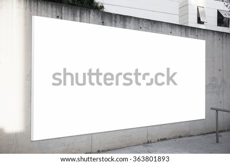 Empty billboard on the concrete gray background. White screen
