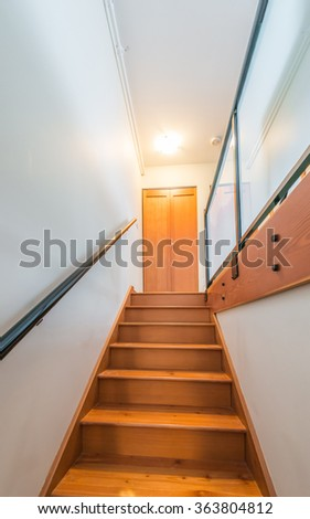 Wooden stairs to the upper level. Interior design. Vertical. #363804812
