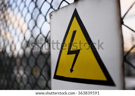 Generic High Voltage Danger Sign,symbol. Black arrow isolated in yellow triangle. Warning icon.