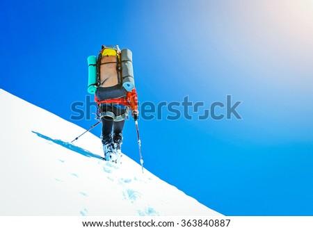 Climber on snowy summit #363840887