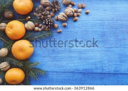 Tangerines and fir branches on old wooden background #363912866