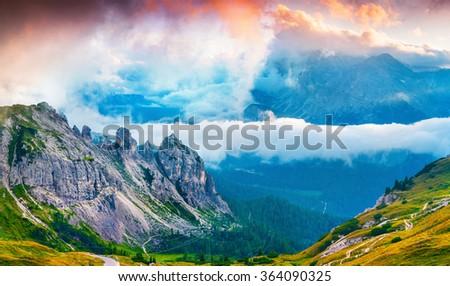Foggy summer scene in the National Park Tre Cime De Lavaredo. Sunset in Dolomites, South Tyrol. Location Auronzo, Italy, Europe. #364090325