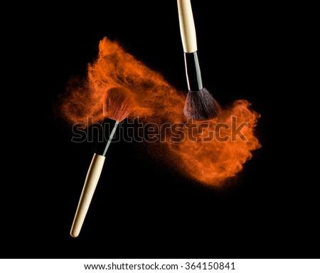 Make-up brush with powder explosion on black background #364150841