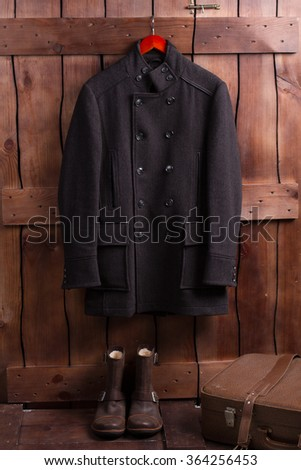 Retro style of menswear. Men's clothing on a dark brown background. #364256453