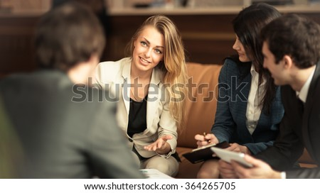 A group of successful businessmen. Discussion of the important contract of the company. Royalty-Free Stock Photo #364265705