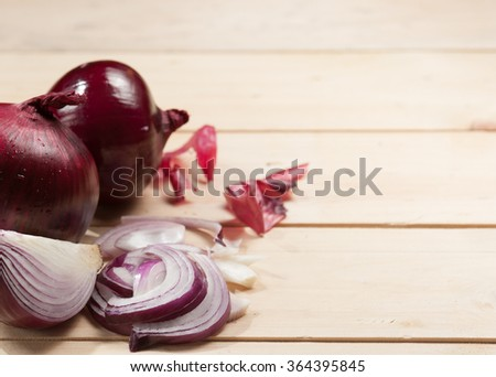 Red onion on wooden background #364395845