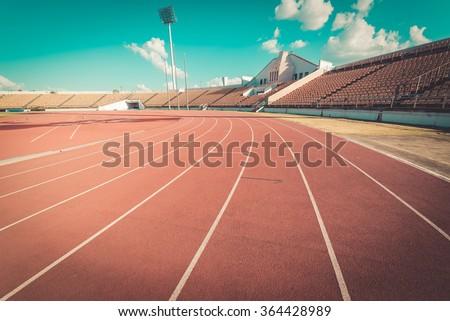Red running track in stadium.