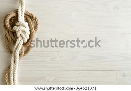 Toned image of ship ropes on white wooden background