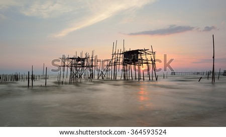 Image of traditional fishermen bamboo jetty known as Langgai during sunset #364593524