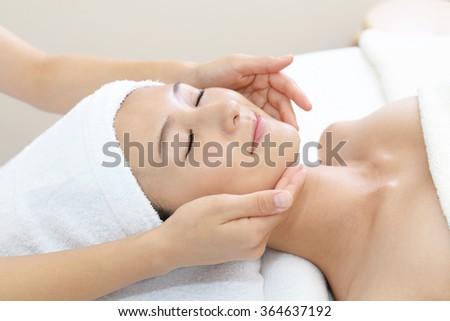 Woman getting a facial massage #364637192
