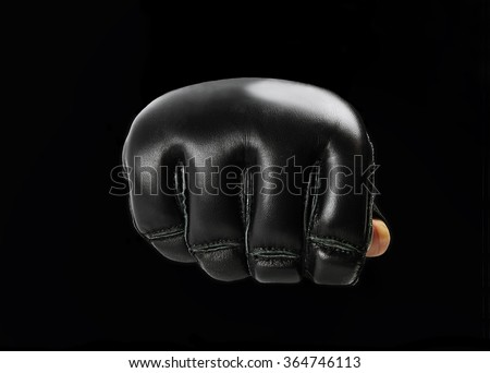 fist black  gloves for martial arts , mma on a black background Royalty-Free Stock Photo #364746113