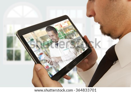 Man having video chat with doctor on laptop at home #364833701