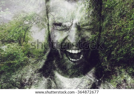 Furious man. Digitally composed image of furious young bearded man keeping mouth open and eyes closed over the picture of green forest