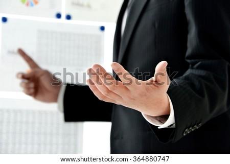 Businessman's hand in presentation in presentation #364880747