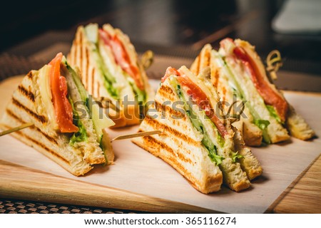 Four sandwiches on the board #365116274