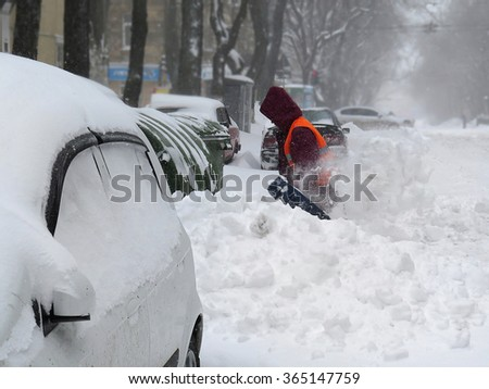 Odessa, Ukraine - 18 January, 2016: janitor. overcast. Natural disasters winter, blizzard, heavy snow paralyzed the city, collapse. Snow covered the cyclone Europe    #365147759