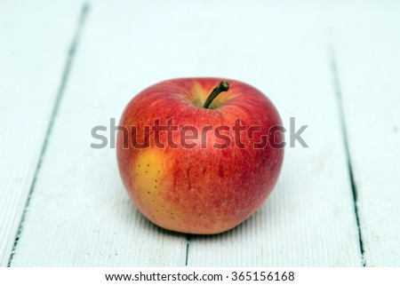 Fresh tasty red apple fruit isolated on a white wooden background. #365156168