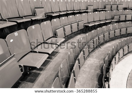 Vintage black and white picture of hockey arena benches