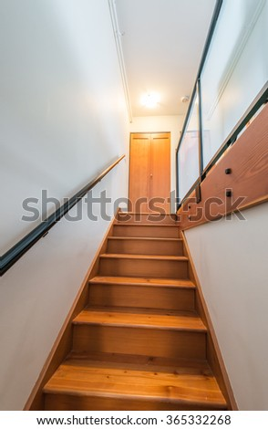 Wooden stairs to the upper level. Interior design. Vertical. #365332268