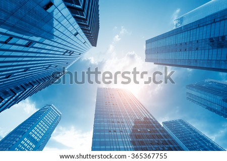 Common modern business skyscrapers, high-rise buildings, architecture raising to the sky, sun. Concepts of financial, economics, future etc. Royalty-Free Stock Photo #365367755
