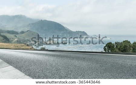 clean highway go aside the bay of ocean, california, usa. #365443646