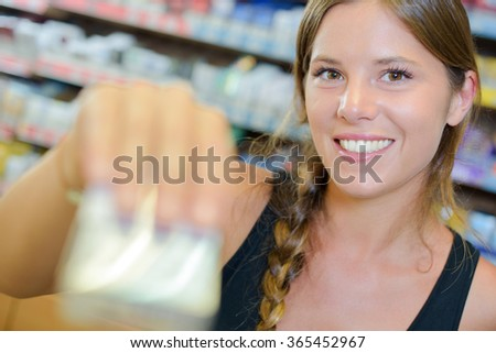 Lady serving blurred packet of cigarettes Royalty-Free Stock Photo #365452967