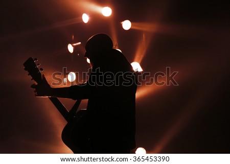 Guitarist plays on rock concert #365453390