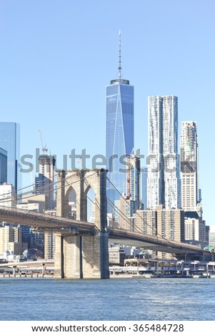 Brooklyn Bridge on winter morning with manhattan buildings in background.