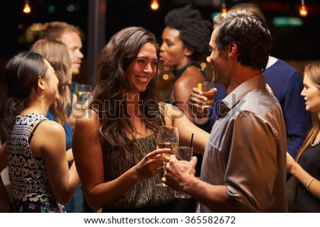 Couples Dancing And Drinking At Evening Party #365582672