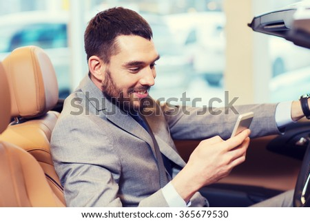 happy man sitting in car at auto show or salon #365679530
