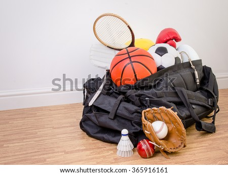 sports equipment in a holdall sports bag on a gym floor. football, rugby, baseball, cricket, basketball, boxing, badminton, squash. with copy space. #365916161