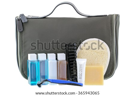 Black traveling cosmetic bag with toiletries in the front, isolated on white Royalty-Free Stock Photo #365943065
