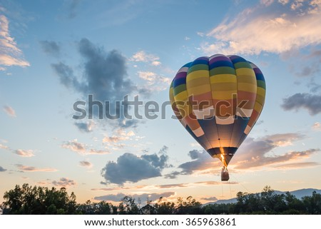 hot air balloon is flying at sunrise #365963861