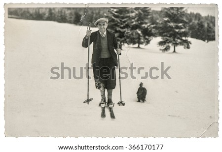 Vintage photo from skiing man in snow. Antique picture with original film grain and scratches